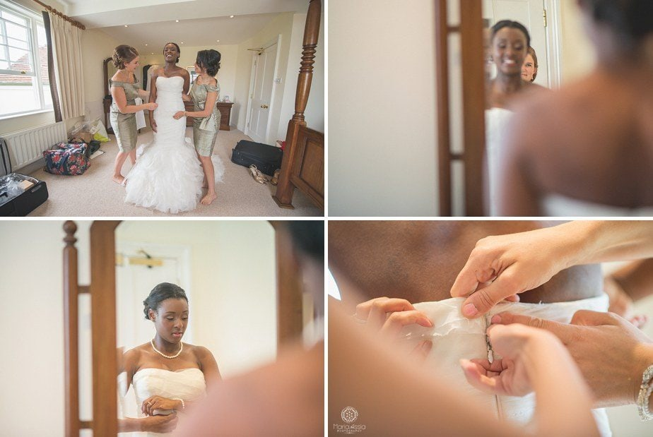 Colourful Ethnic Wedding Bride putting her Vera Wang wedding dress on