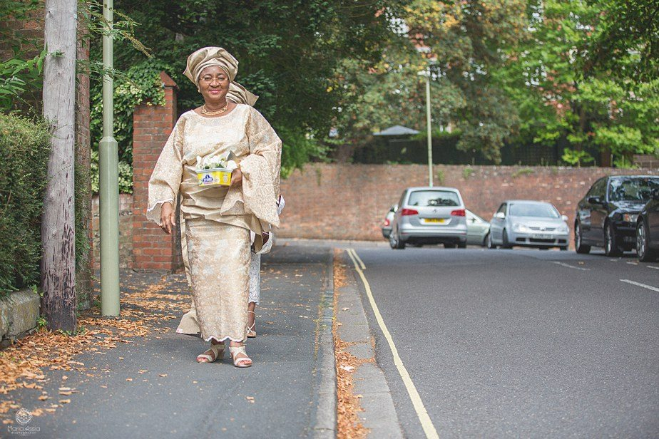 Colourful Ethnic Wedding Nigerian Dressed women walking towards the church