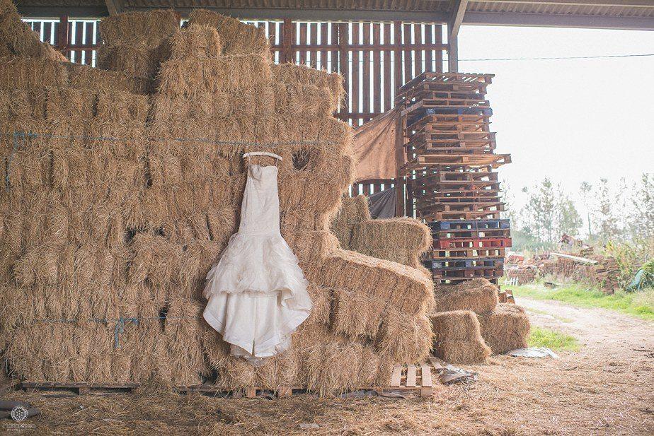 Vera Wang Wedding dress hanging on hay bales