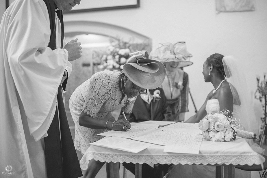 colourful ethnic Wedding witnesses signing the wedding register