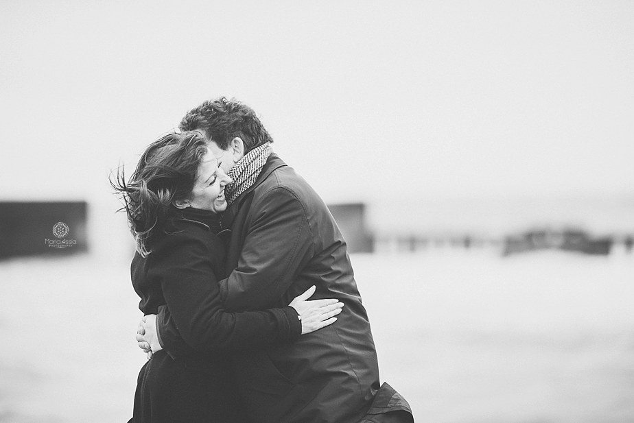 A couple hugging at their pre wedding shoot in Hastings