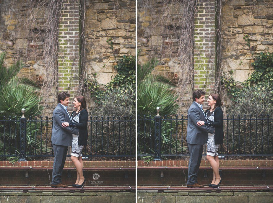 A couple laughing in a square on their Hastings pre wedding shoot