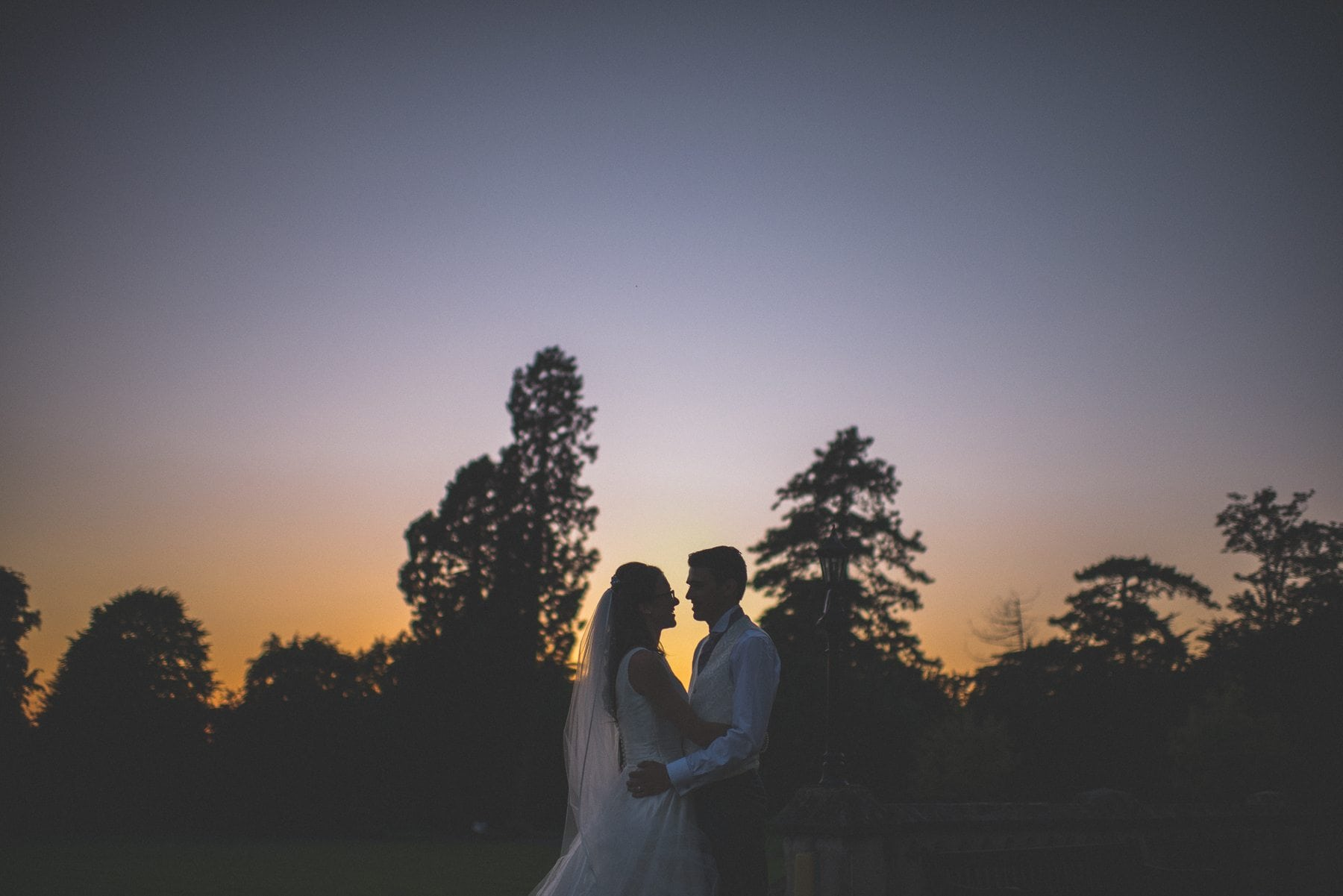 Bride and groom silhouette at sunset at their Horsley Towers wedding
