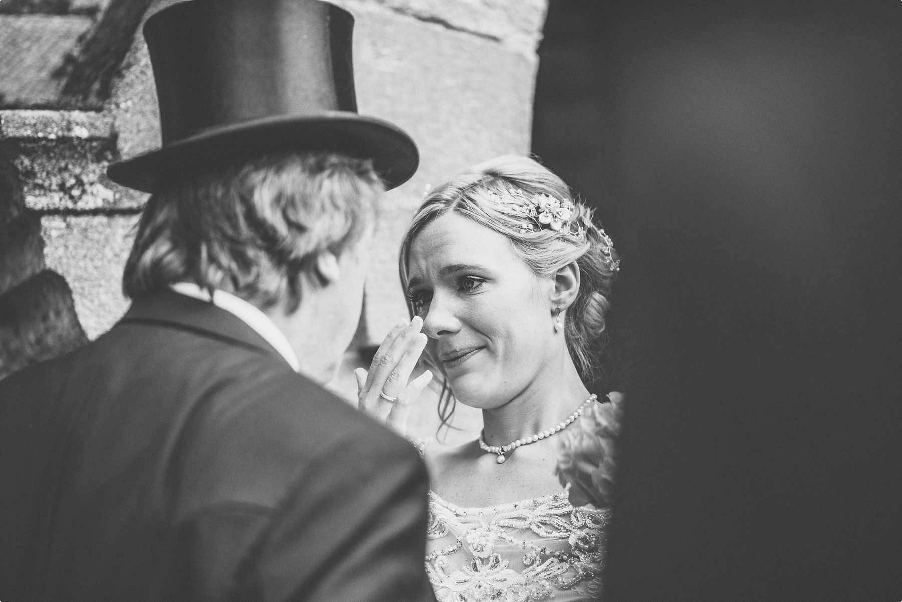 Bride crying happy tears with her dad at Coworth Park Barn summer wedding church