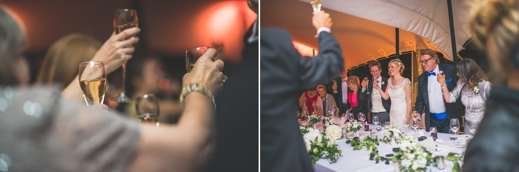 Wedding guests toasting the bride and groom at their coworth park barn summer wedding