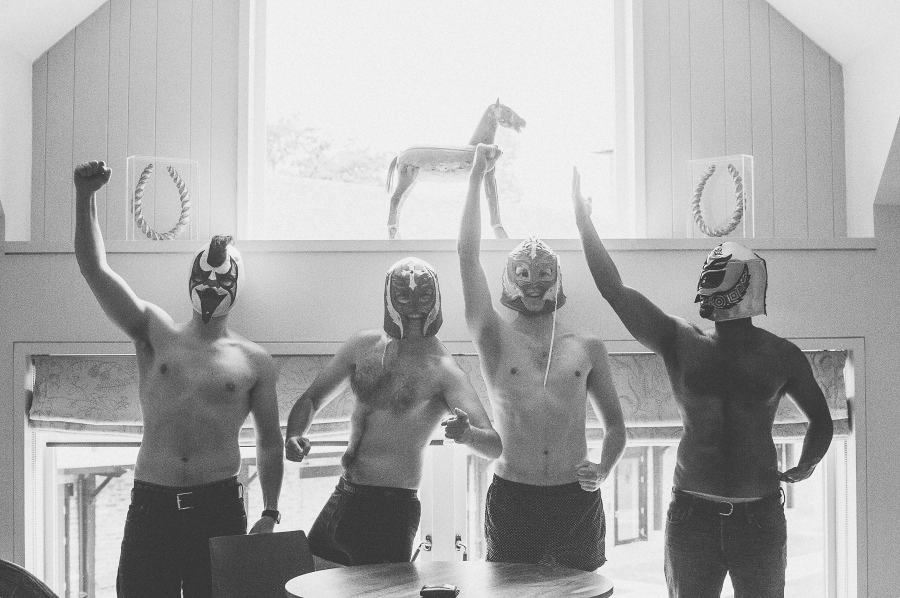 Groom and groomsmen wearing boxershorts and Mexican wrestling masks