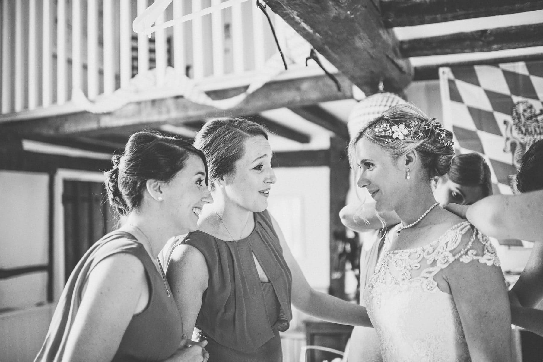 Bridesmaids looking at the beautiful bride as she gets into her pronovias wedding dress