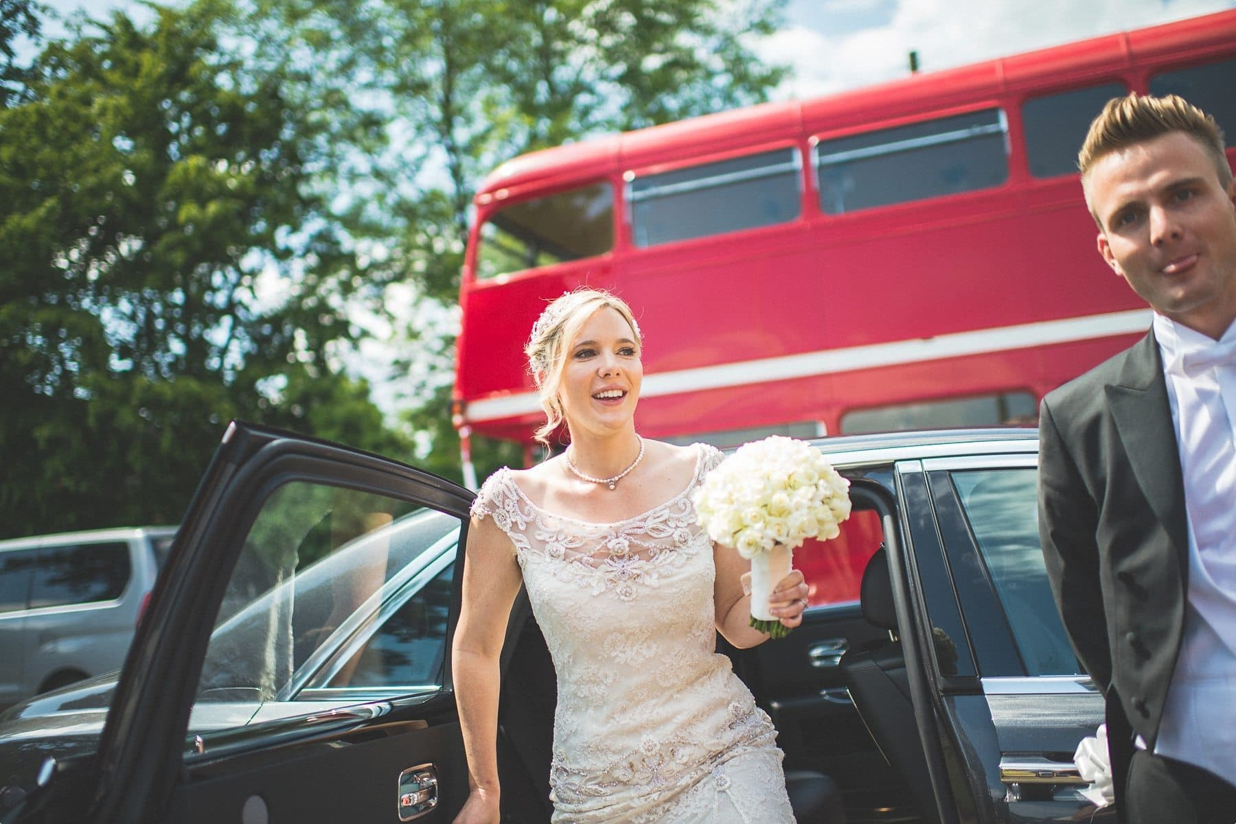 Coworth Park Bride getting out of her wedding car at St Michael and all Angels church