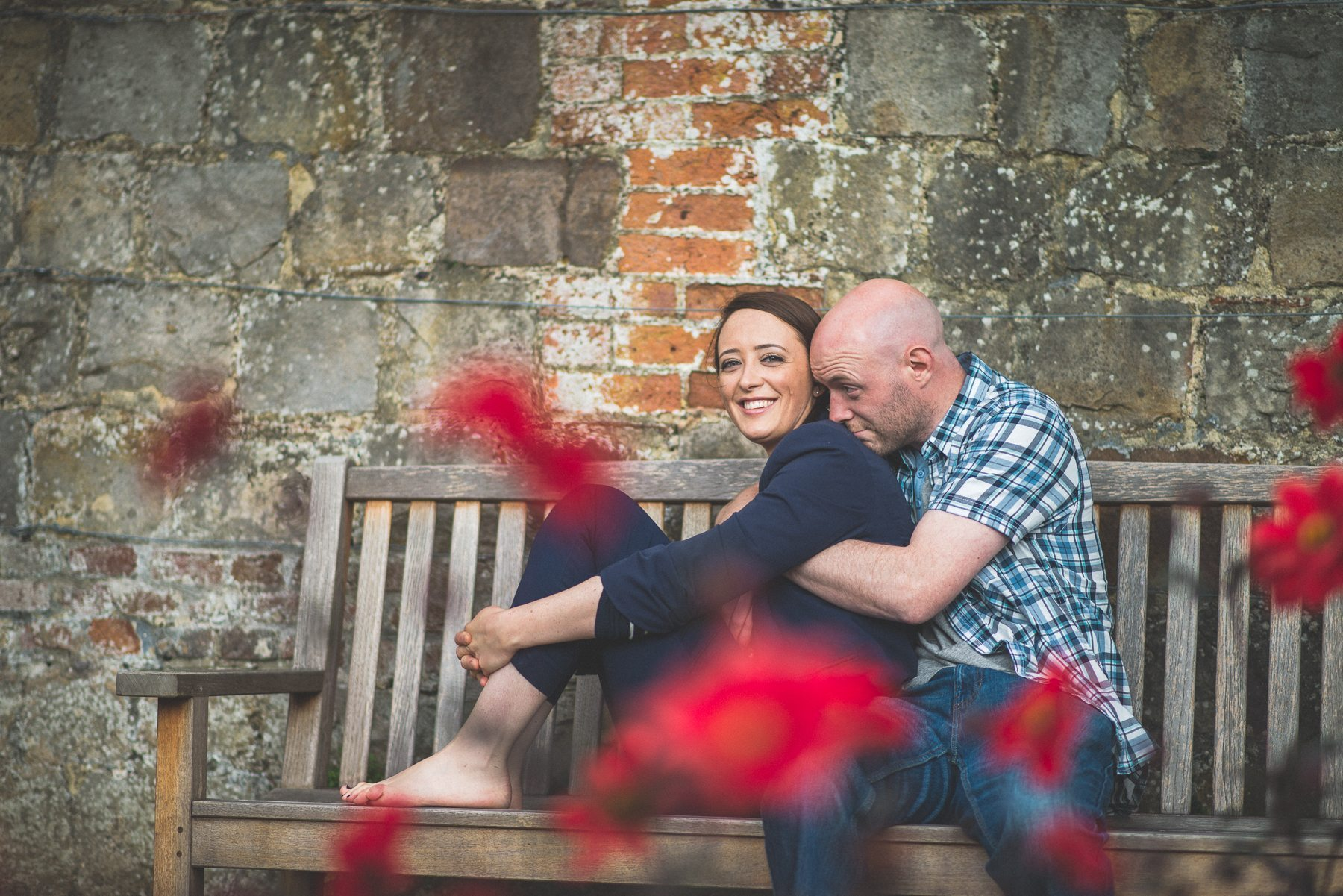 Farnham Castle Misty early morning engagement shoot couple sitting on a bench by Maria Assia Photography