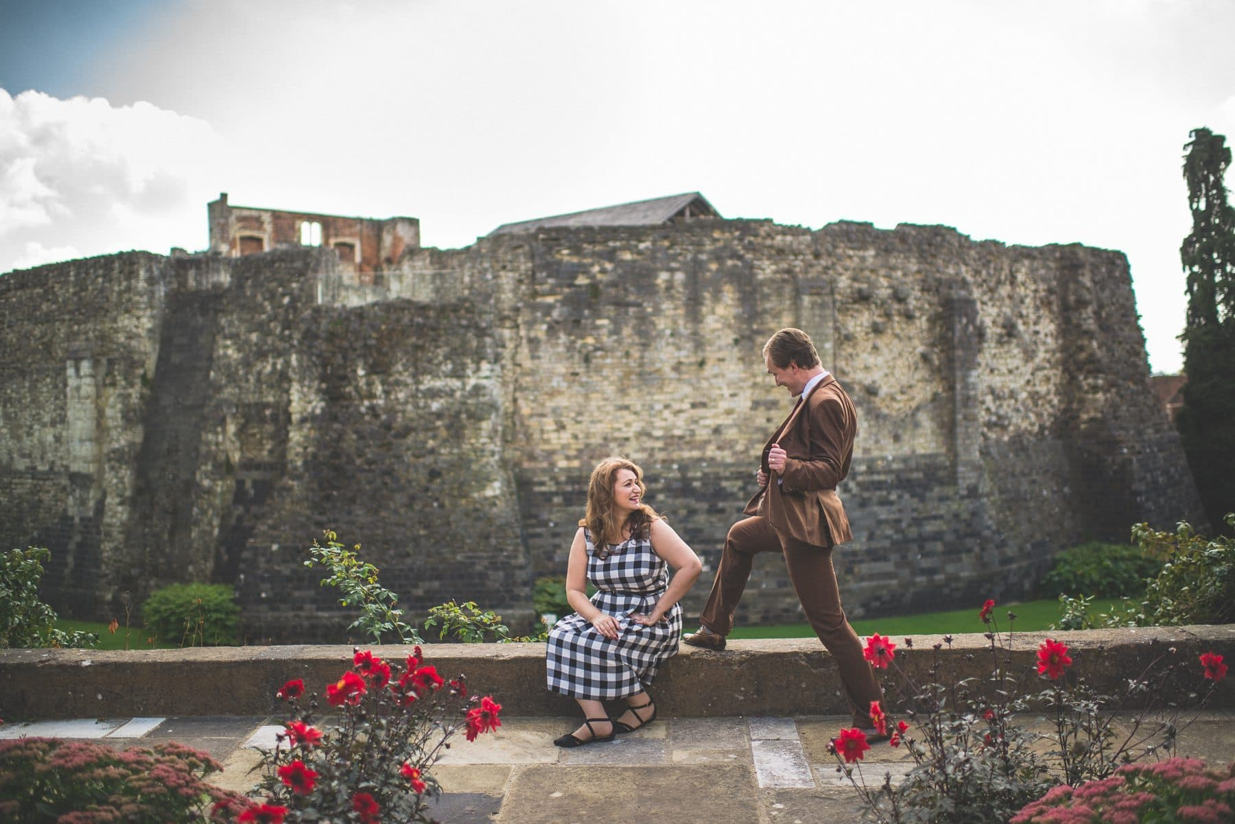 Couple goofing around at Farnham Castle Keep at their tweed & petticoats pre-wedding shoot by natural alternative wedding photographer Maria Assia Photography