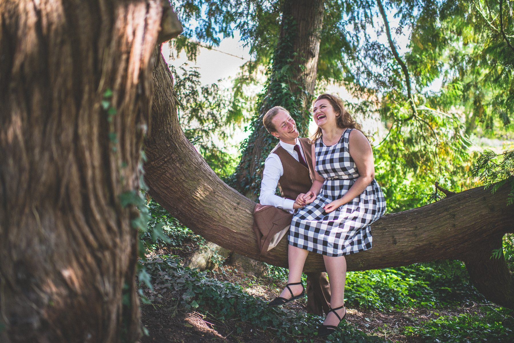 Engaged couple laughing out loud at their documentary creative alternative Farnham Castle petticoats & tweed pre-wedding shoot