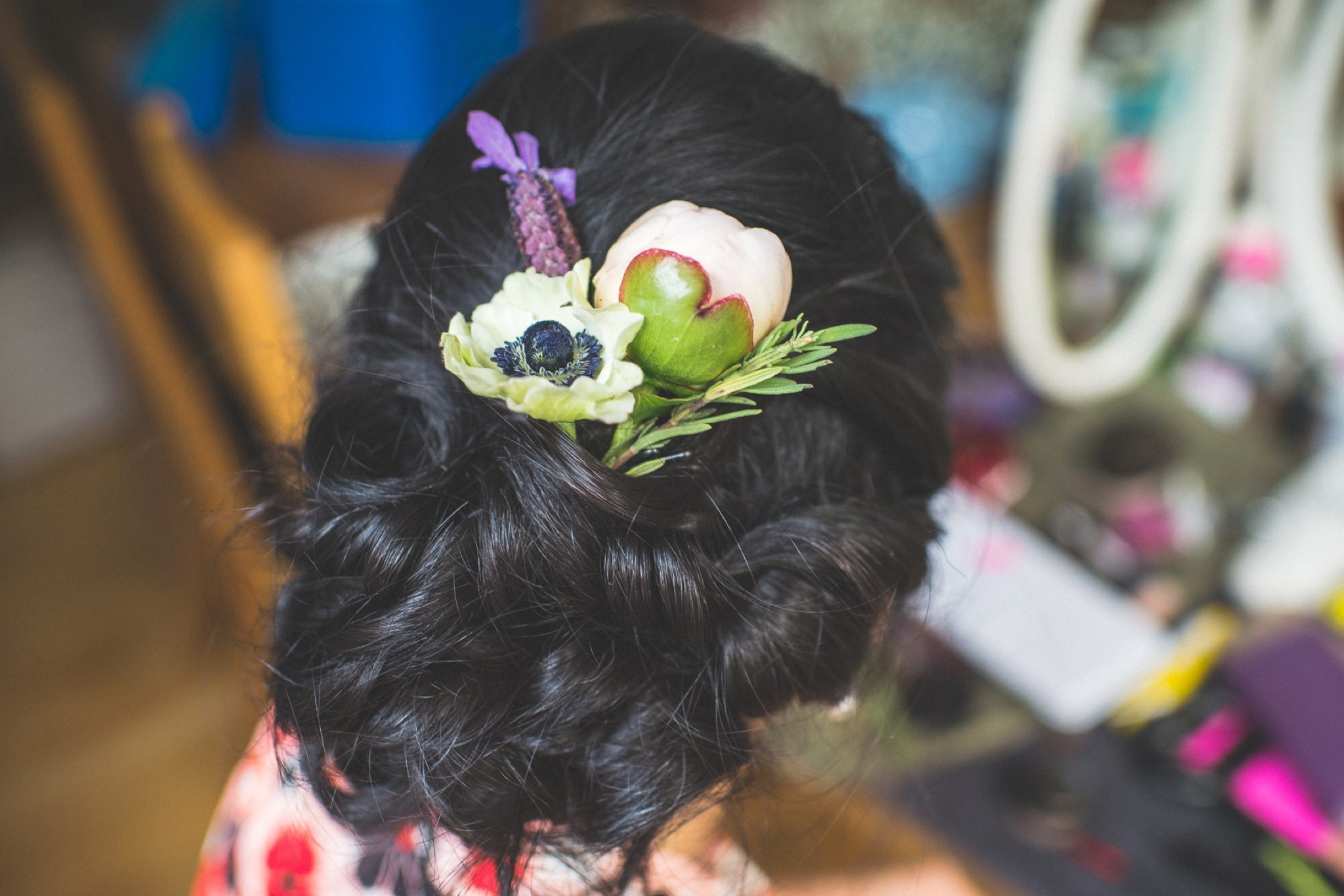 Bride's hair dressed with peonies poppies and lavender for her Two Temple Place Wedding