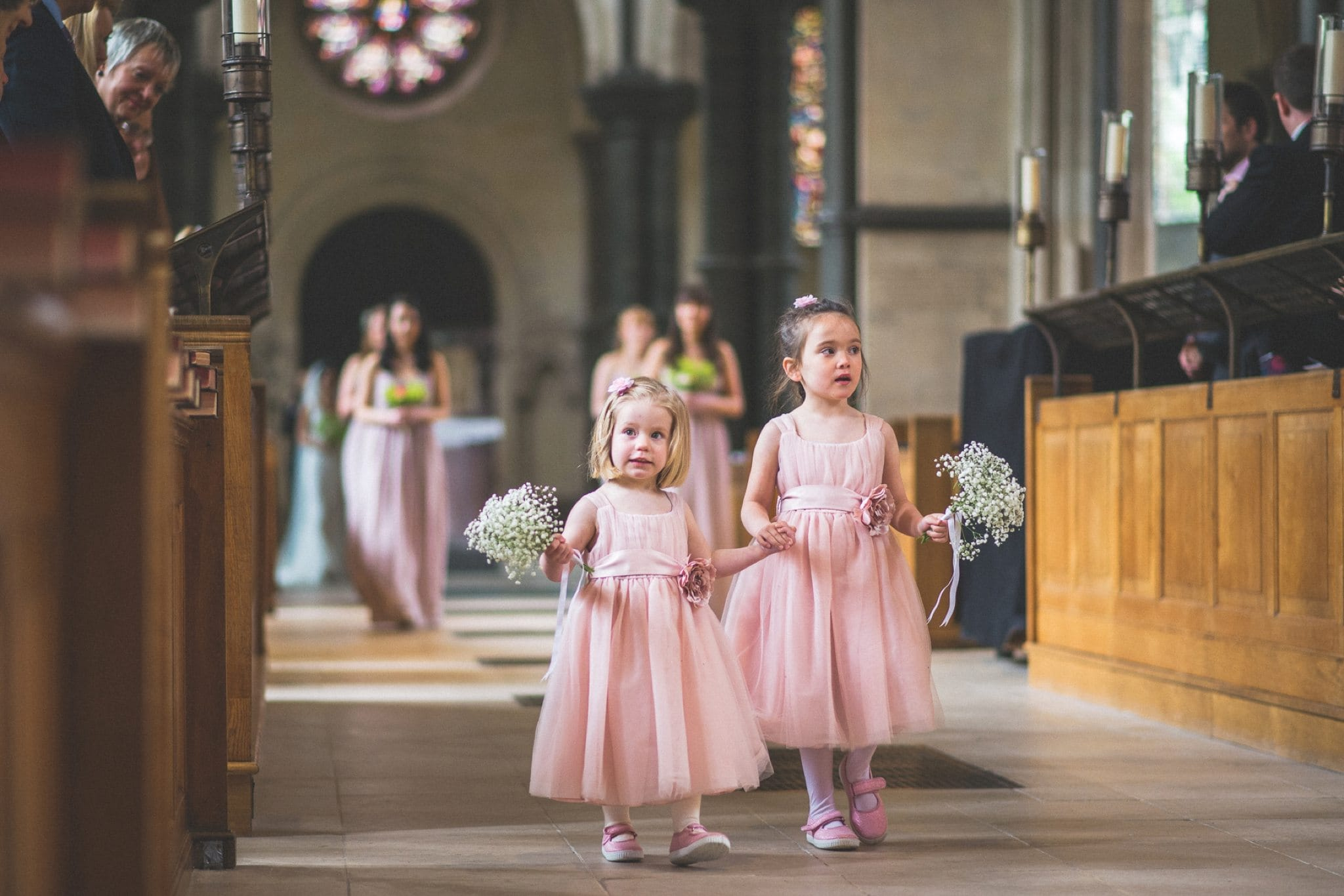 Flower girls walking down the aisle at Temple Church in Inner Temple in the City of London