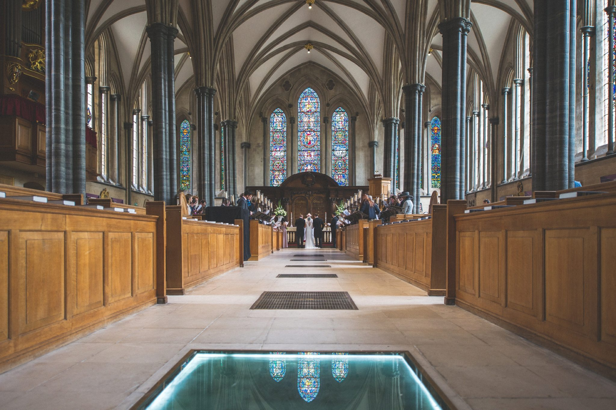 Temple Church wedding with stained windows reflecting on the floor