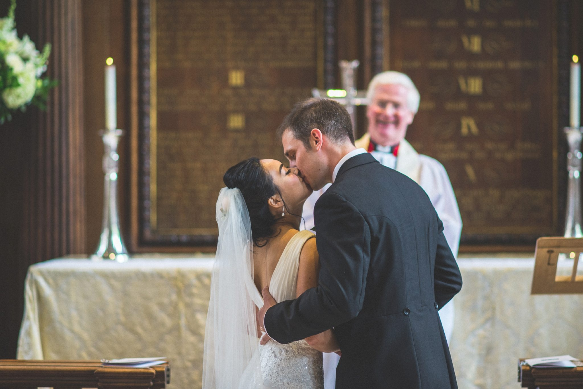 Bride and Groom kissing at their London Temple Church Wedding