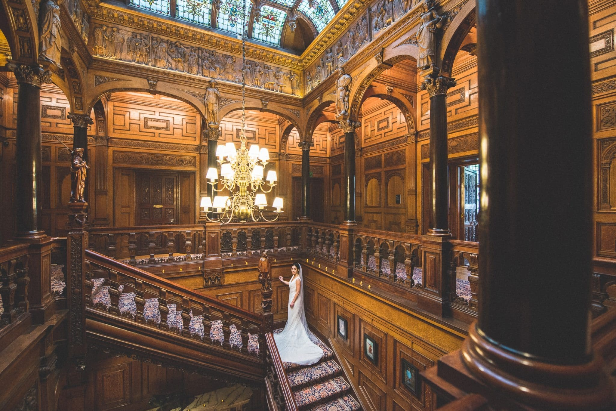 Bride standing on the stairs and gallery at Two Temple Place