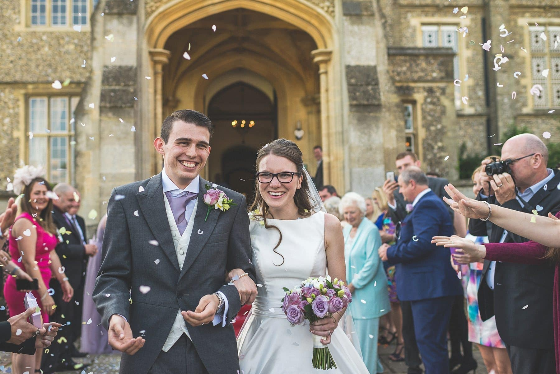 Bride and groom covered in confetti at De Vere venues Horsley Towers autumn wedding