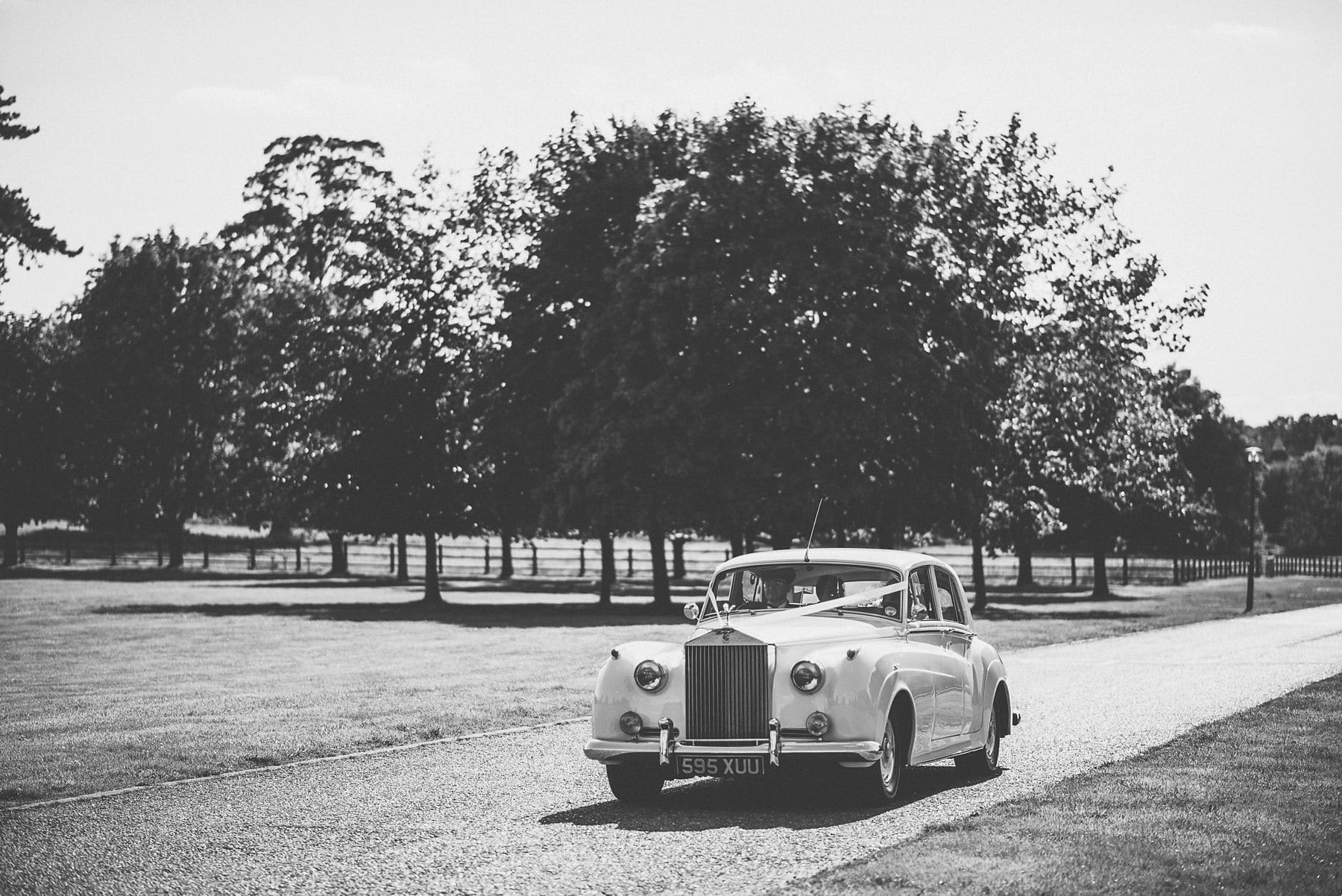 Vintage Rolls Royce wedding car driving down the long drive at Horsley Towers