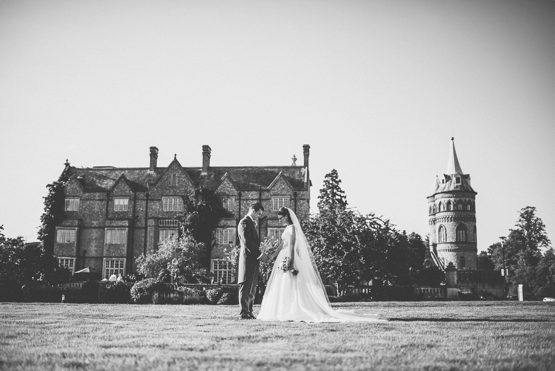 Bride and groom holding hands in front of Horsley Towers wedding venue