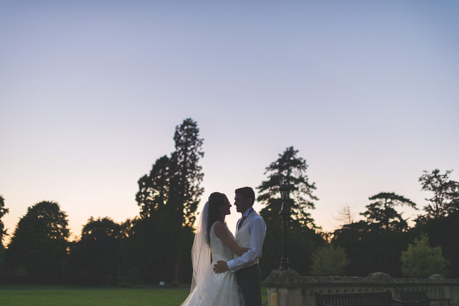 bride and groom sunset portrait at their sunbathed funfilled Horsley Towers autumn wedding