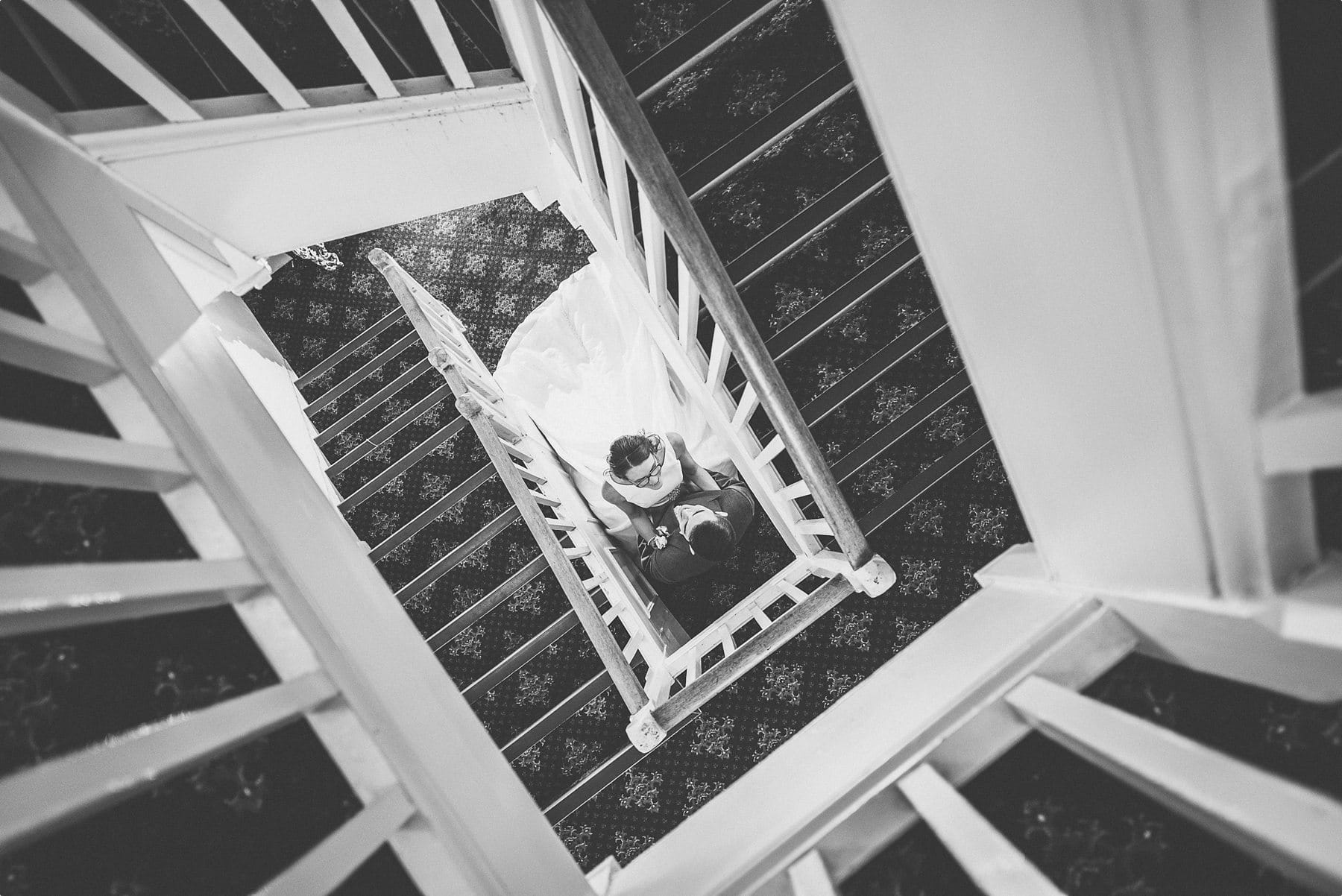 Bride and groom at Horsley Park staircase