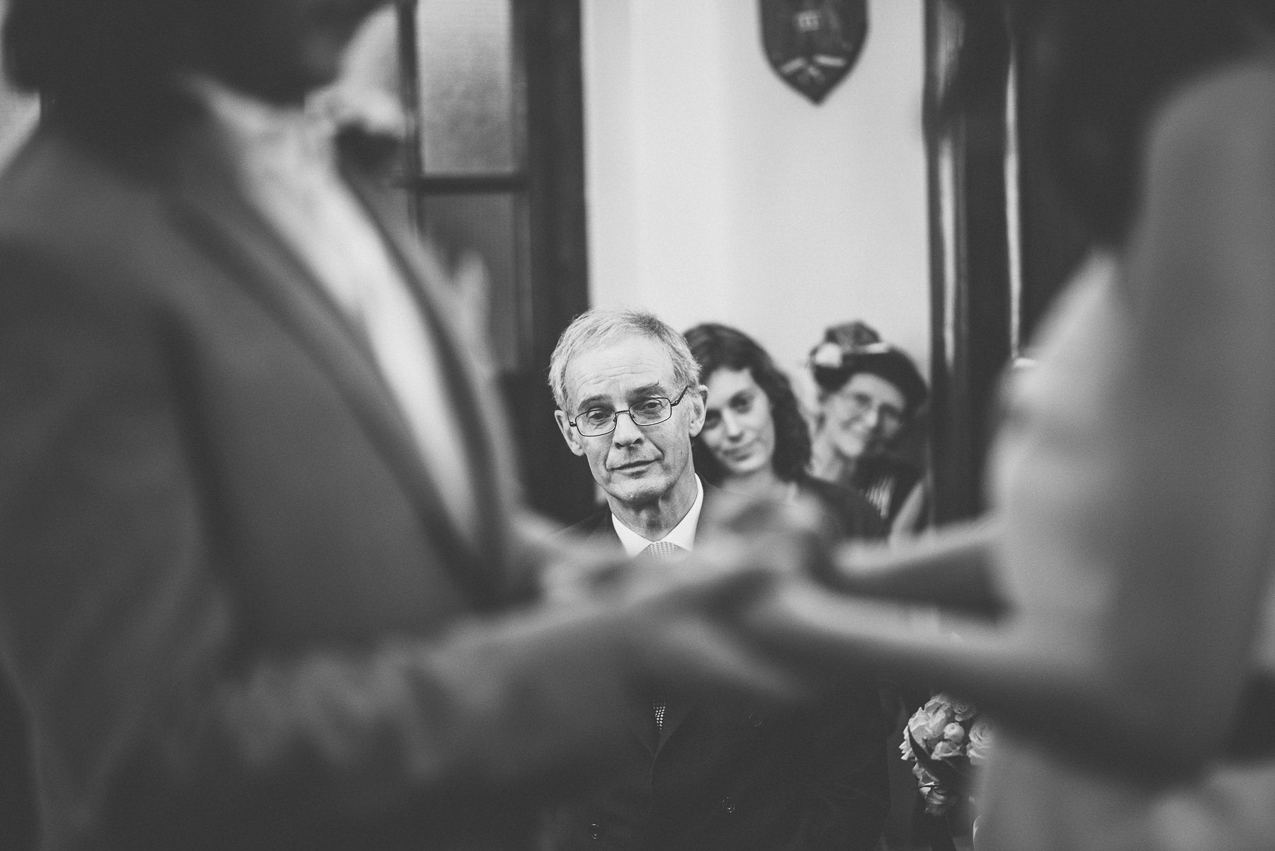 Father of the bride crying as he watches the bride and groom getting married at the Chelsea Town Hall wedding