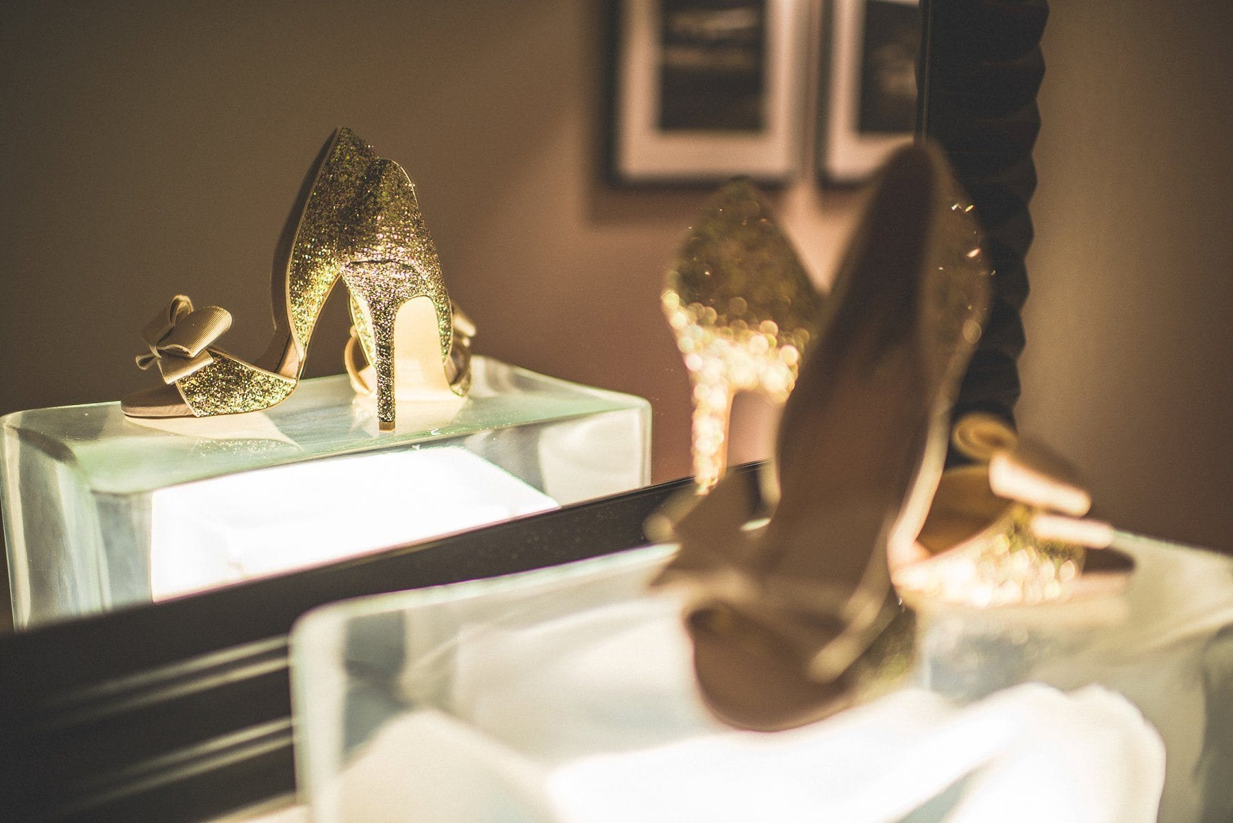 Golden sparkly wedding shoes and their reflection at the Chelsea Harbour Hotel in London