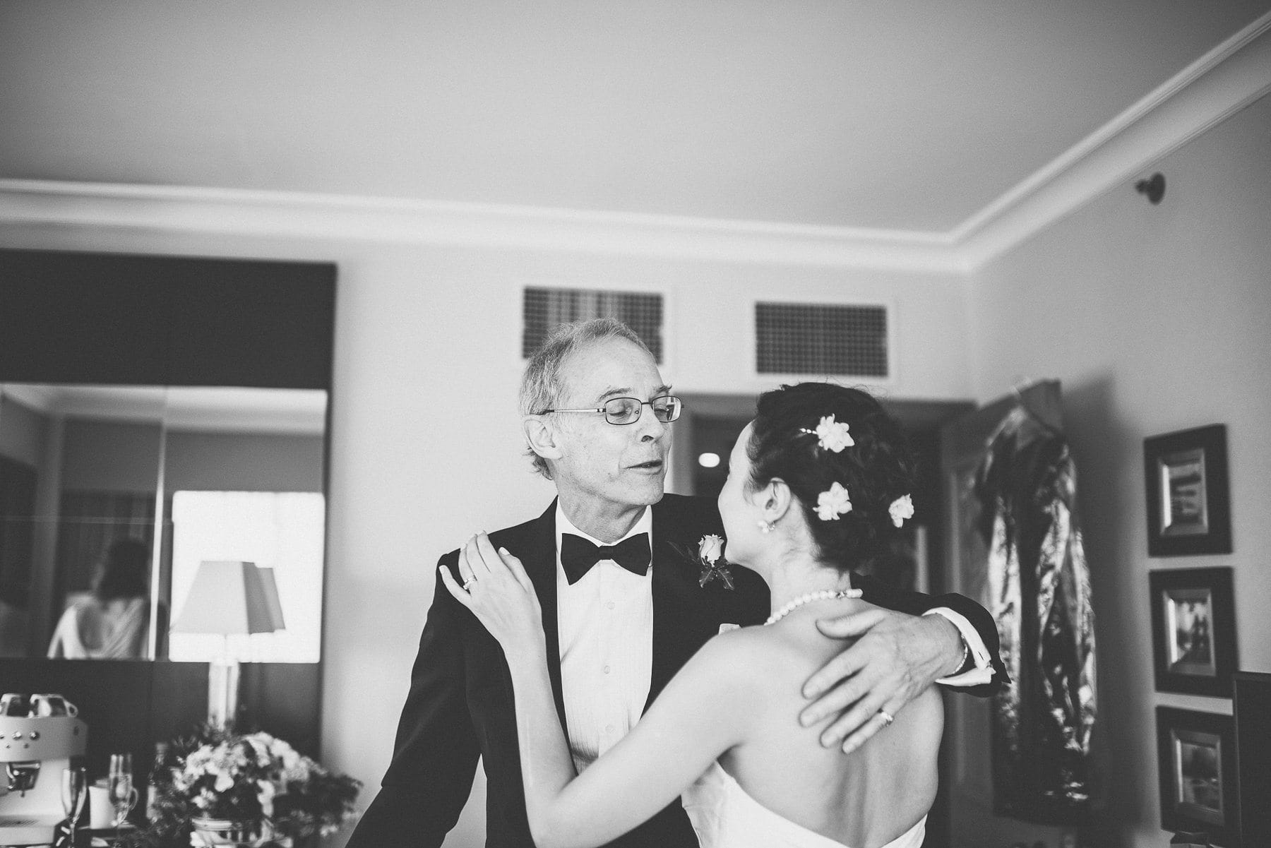 Father of the bride kissing his daughter as he sees her ready for the first time at the Chelsea Harbour Hotel