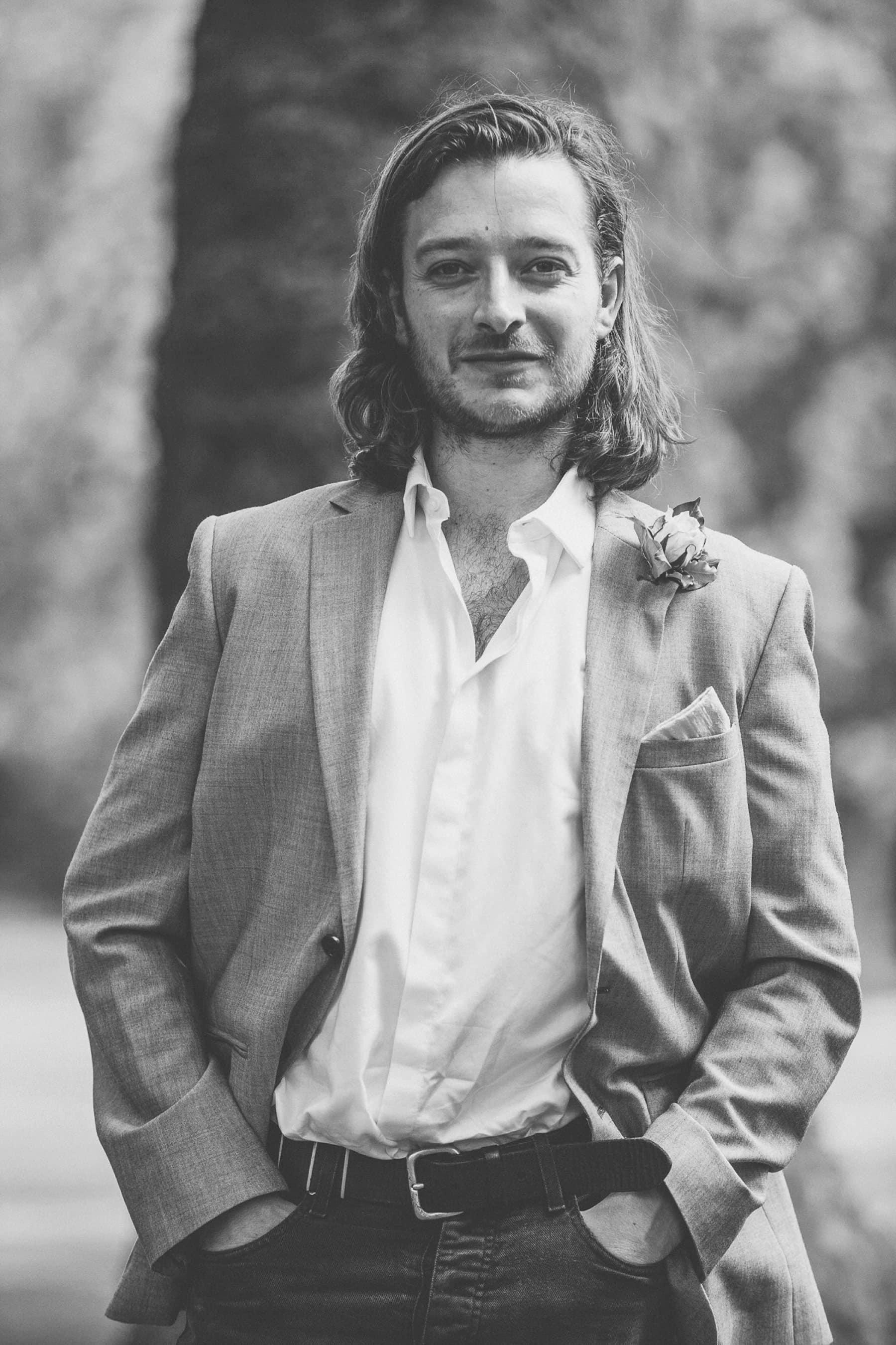 Handsome groom at his Hurlingham Club wedding