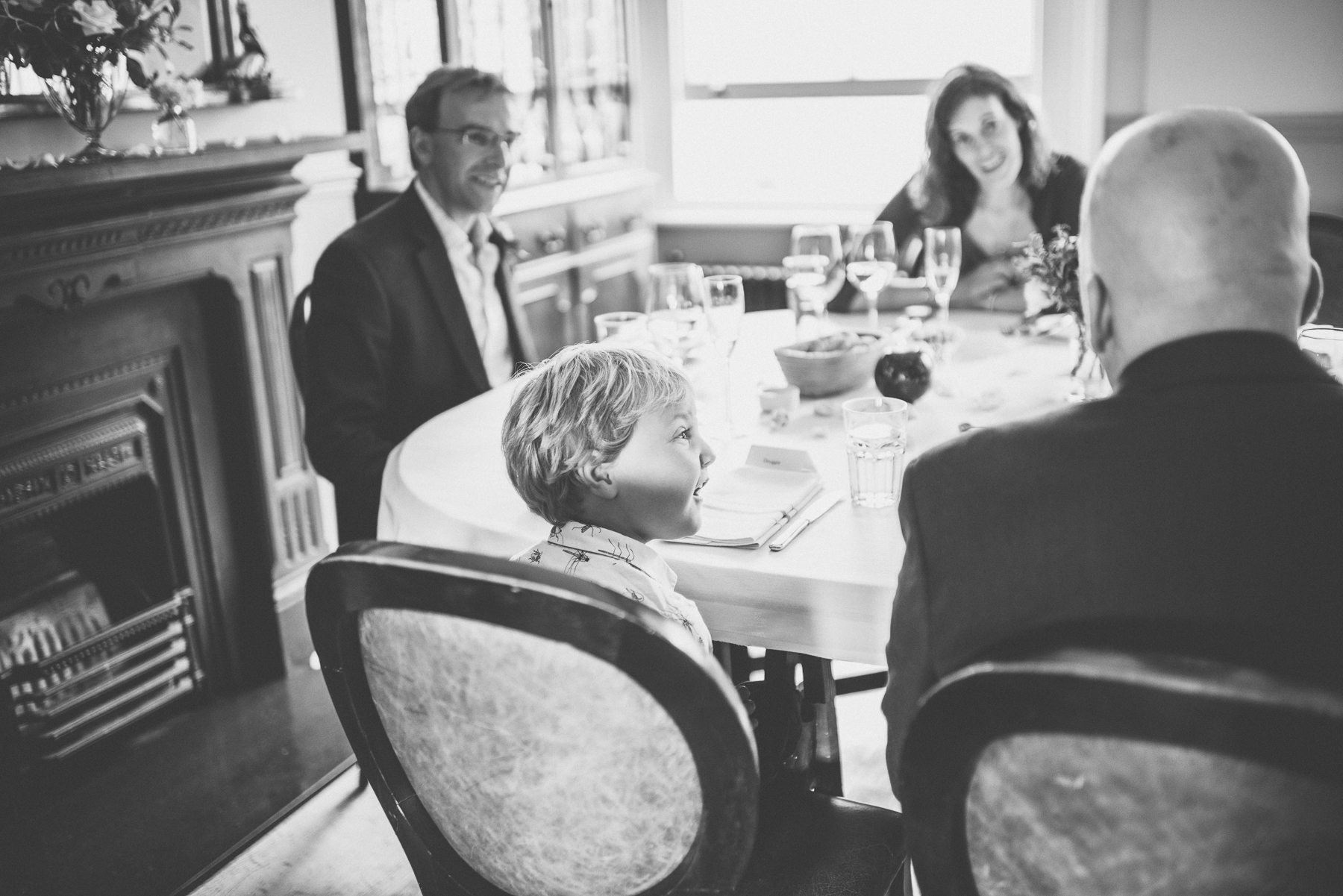 Wedding guests chatting over lunch captured by Chelsea Wedding photographer Maria Assia