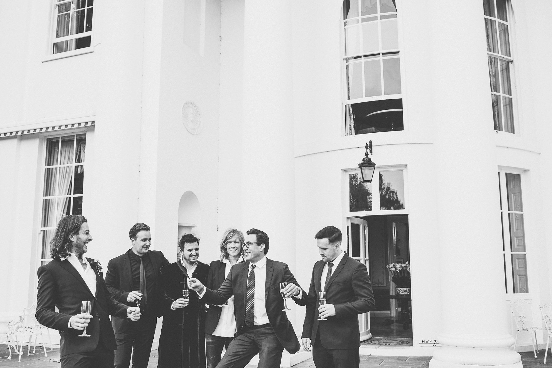 Groom and groomsmen dancing and joking around at the Hurlingham Club Glamorous Music Themed Chelsea Wedding
