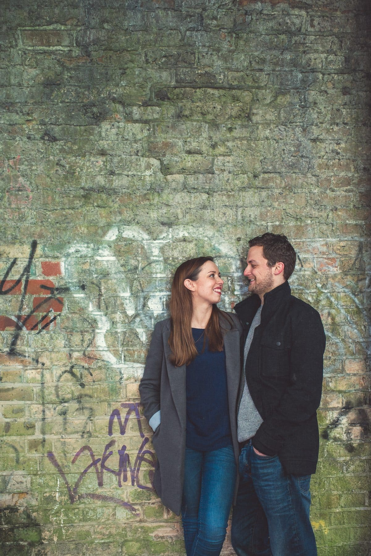Kent Downs romantic relaxed engagement shoot couple standing in a tunnel with graffitti