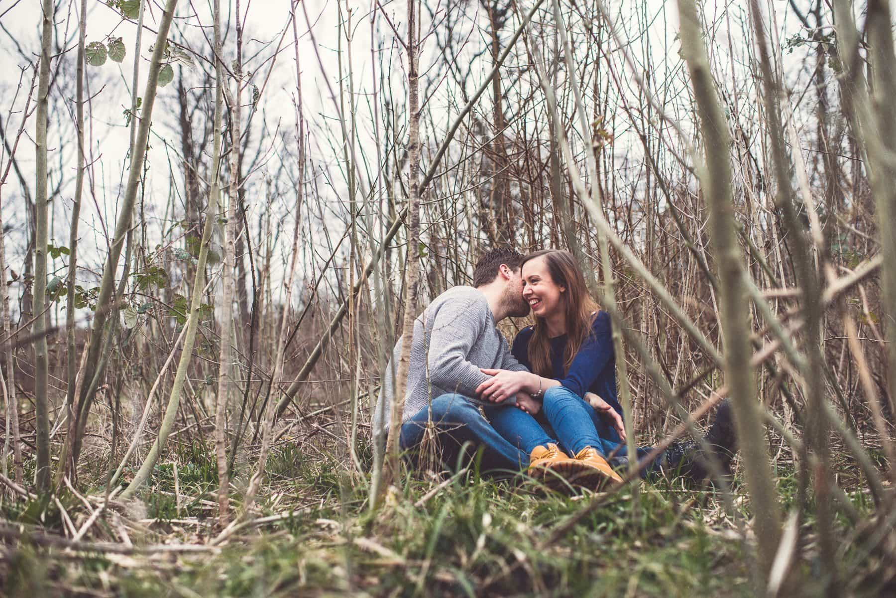 Couple laughing in a bamboo field surrounded by twigs and bamboo by creative wedding photographer Maria Assia Photography