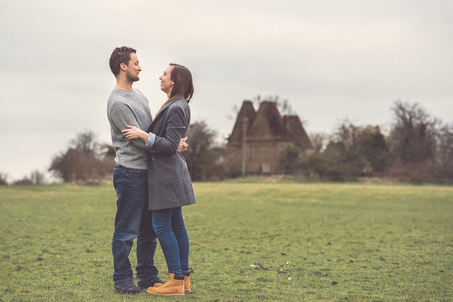 Couple on their St Julians Club engagement shoot overlooking the Kent Downs and three Oasthouses