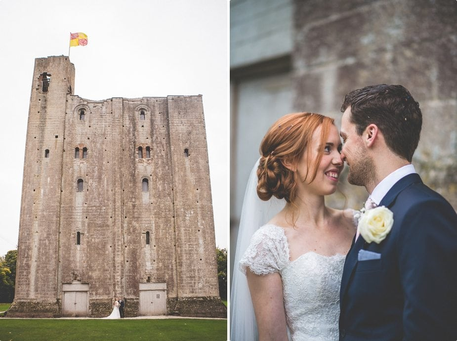 Bride and groom smiling at each other in front of Hedingham Castle