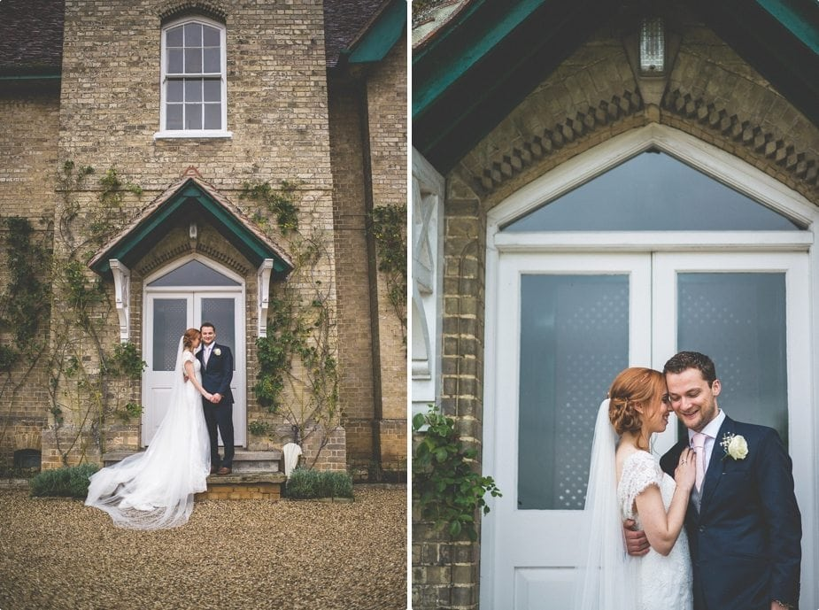 Bride and groom hugging and holding hands in front of Smeetham Hall Barn Manor house
