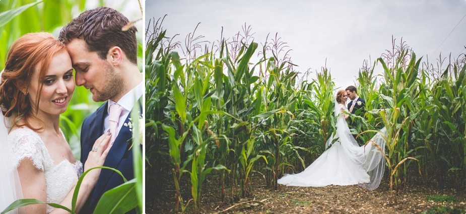 Bride and groom standing in the corn field at their Smeetham Hall Barn rustic rainy wedding by best wedding photographer Maria Assia Photography