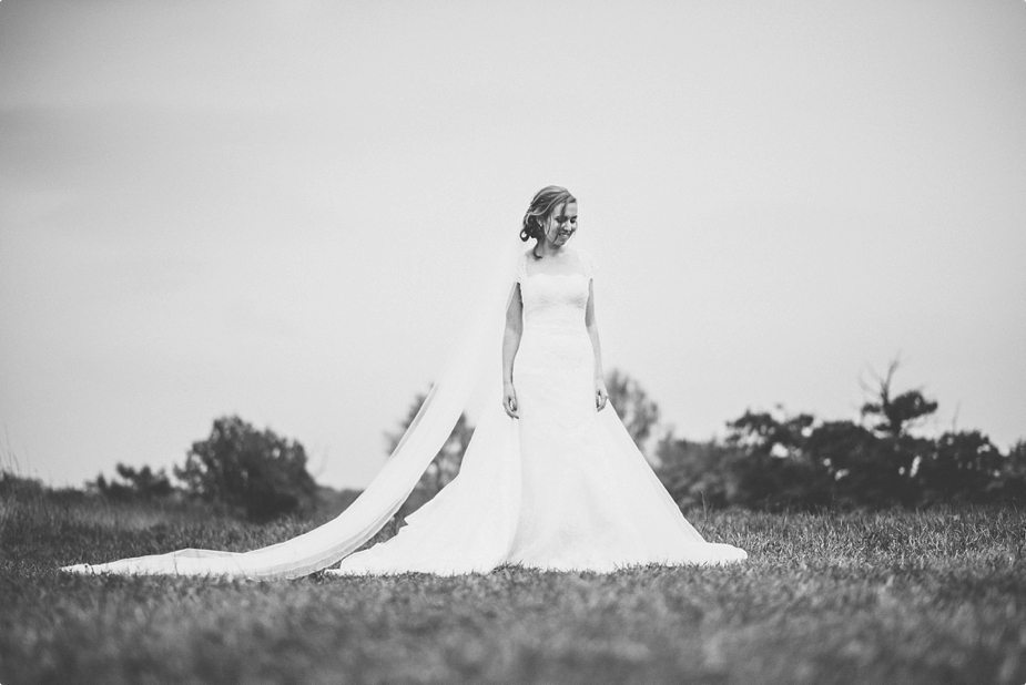 Bride wedding portrait at Smeetham Hall Barn field