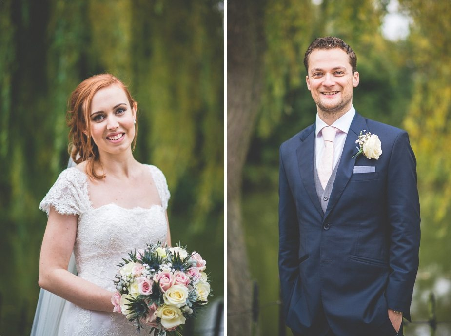 Bride and groom portraits standing at the lake at Smeetham Hall Barn