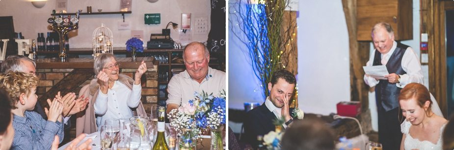 Bride and groom laughing at the father of the bride's speech at their Smeetham Hall Barn wedding