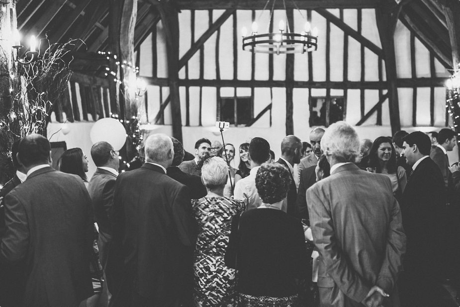 Bride at Smeetham Hall Barn taking a selfie with her wedding guests and a selfie stick