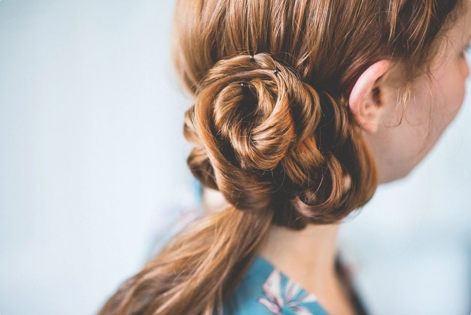 Red haired Bride's messy side bun at The Old Rectory Country House