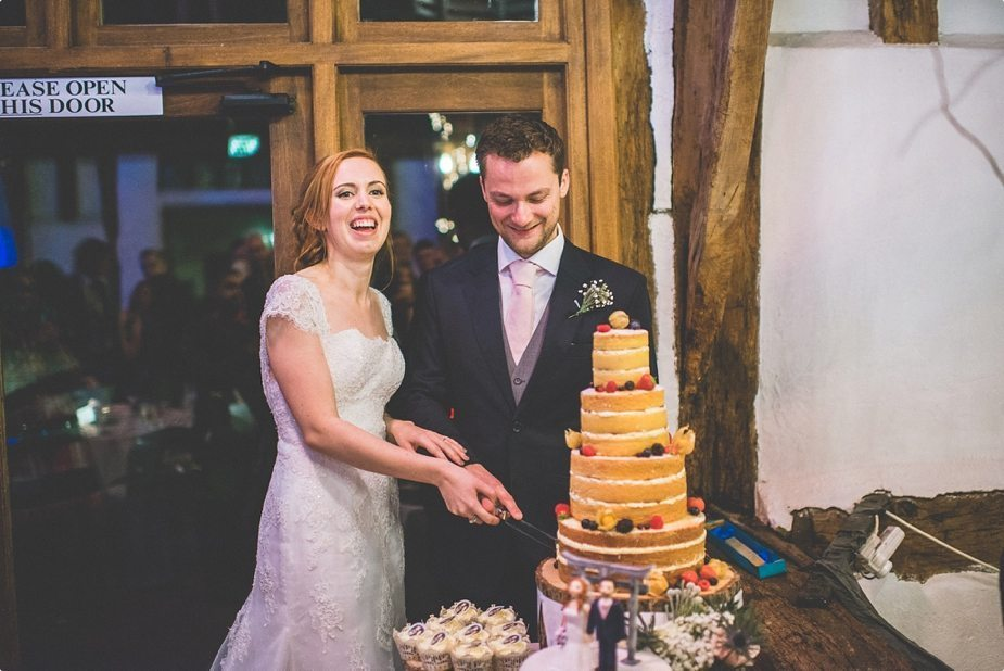 Smeetham Hall Barn wedding Bride and groom cutting their naked wedding cake