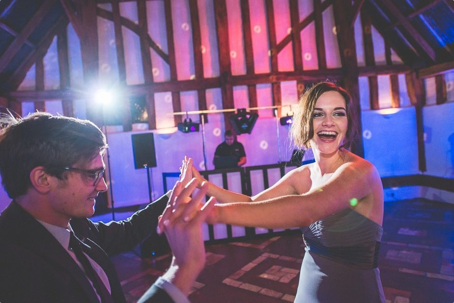 Wedding guests laughing and dancing at a Smeetham Hall Barn Wedding