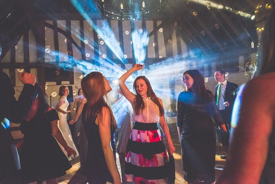 Wedding guest dancing in starburst trailing light at Smeetham Hall Barn
