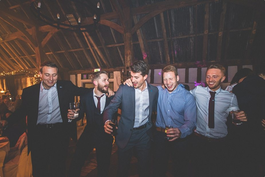Boys dancing with drinks in their hands at Smeetham Hall Barn wedding