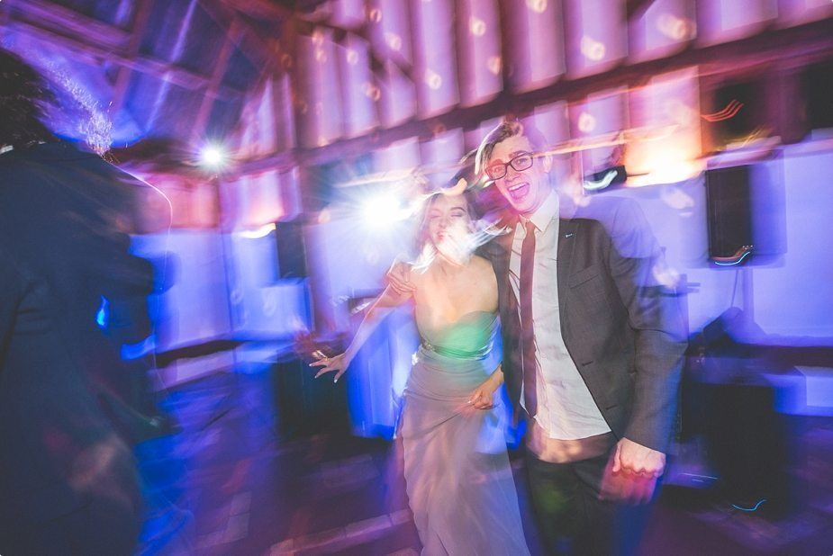 Bridesmaid dancing and laughing at Smeetham Hall Barn