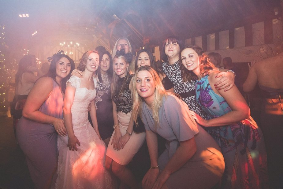 Bride and bride's friends having fun on the dancefloor
