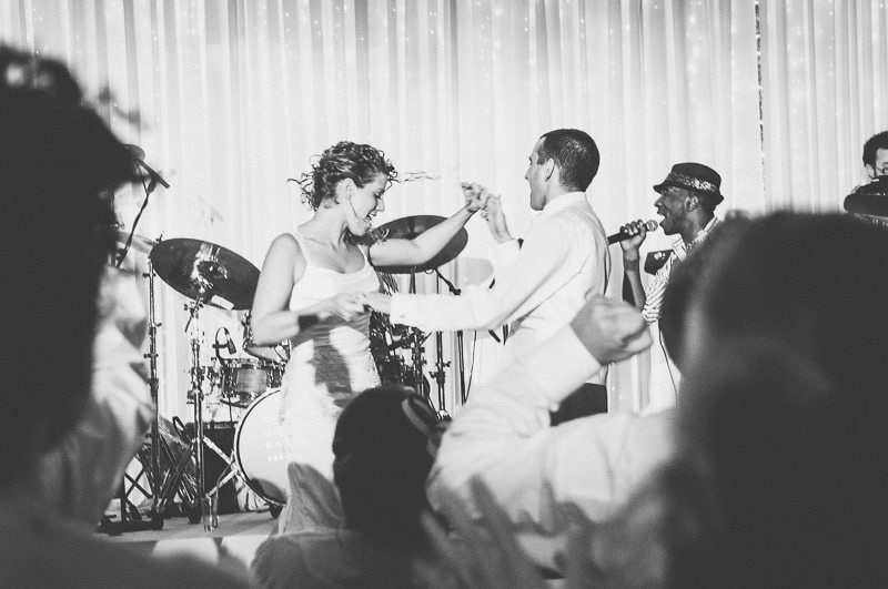 Bride and Groom dancing on the stage at their Jewish Wedding by Maria Assia Photography