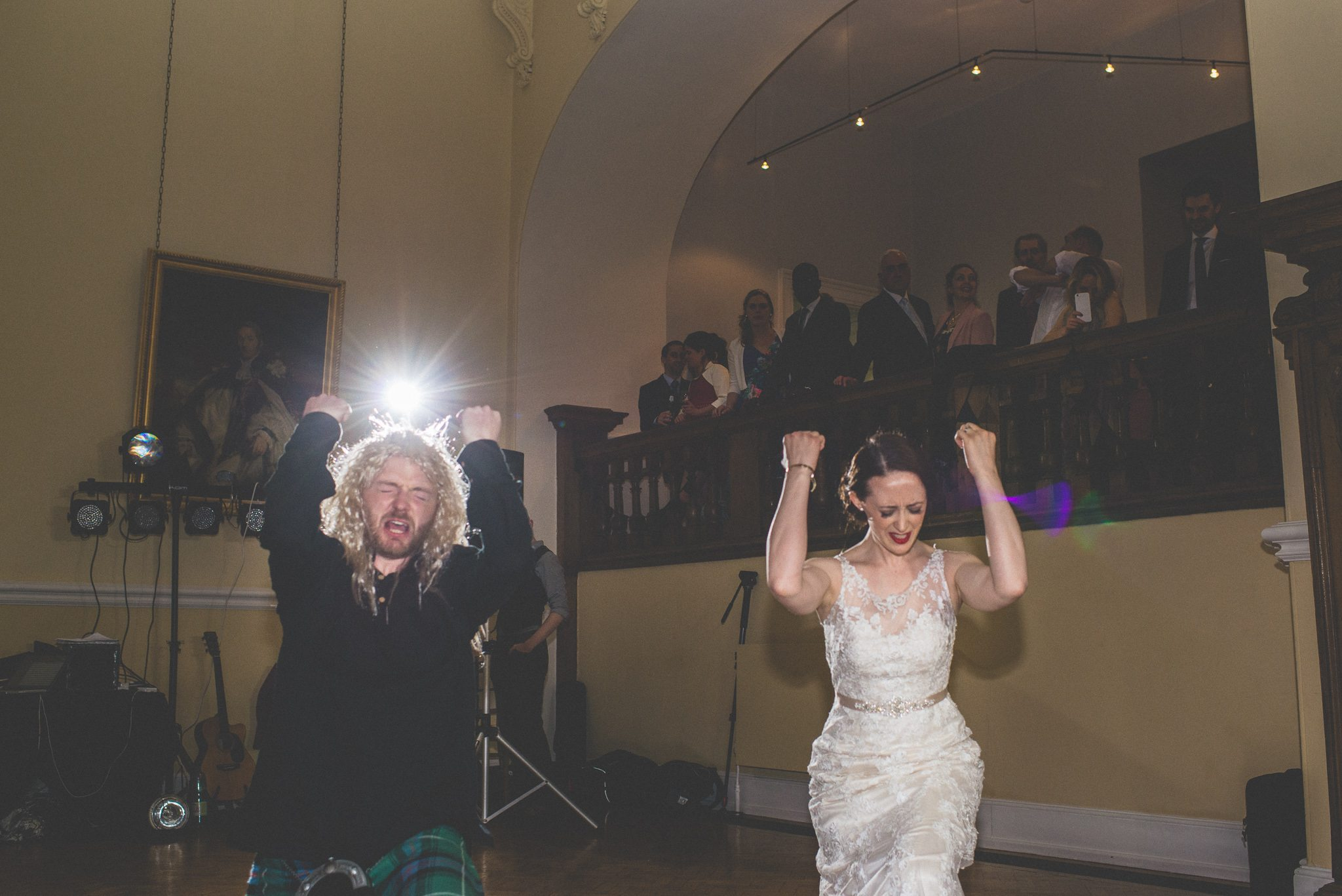 Bride and groom dancing a parody first dance at Farnham Castle Great Hall wedding